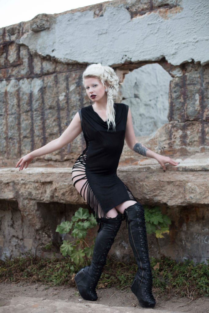 NeoLoc Technology by Tarantula on Stilts, woman with white dreadlocks sitting on a rock wall